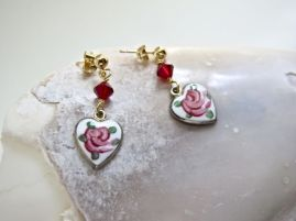These dainty hearts were part of a broken anklet. I paired them with Swarovski crystals. (Sold)