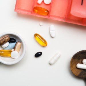 Medicine measured out for a daily dose to take tablets