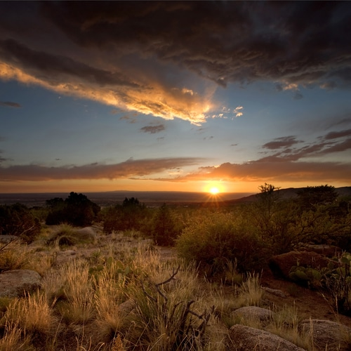 A majestic sunset over the Chihuahuan Desert at the base of the Sandia Mountains, outside of Albuquerque, New Mexico