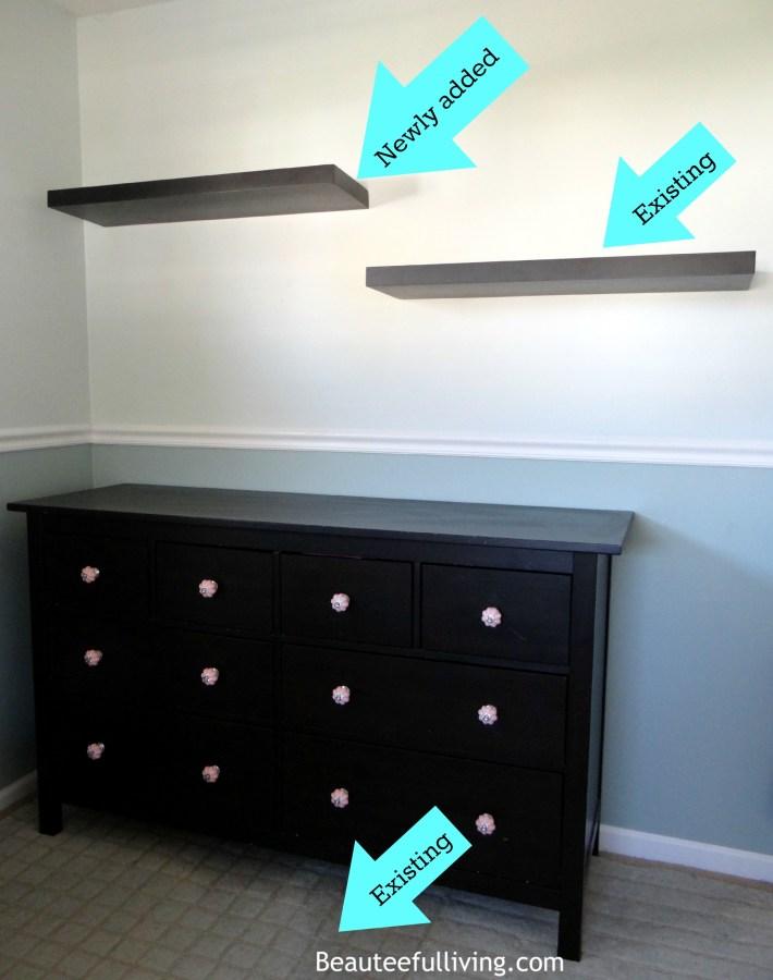 Dresser area with floating shelves