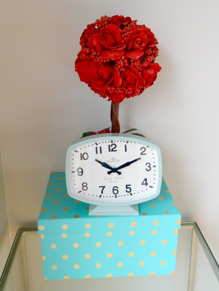Teal clock in dining room