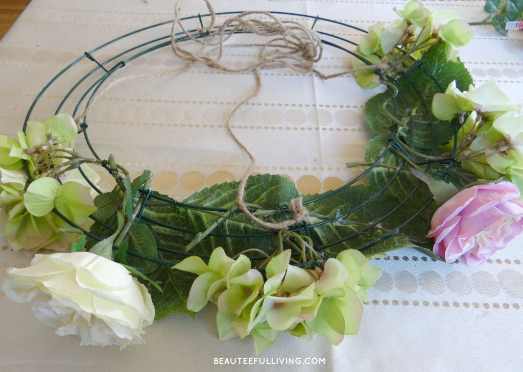 Adding flowers to wreath