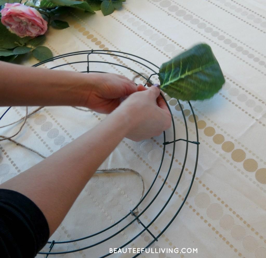 Placing leaf on wreath