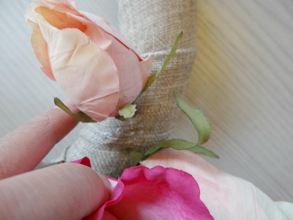 Placing silk flowers