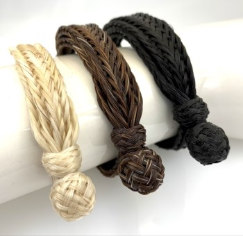 25 strand braided horsehair bracelet in the three available stock colors: white, chestnut and black.