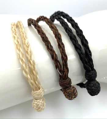 The three stock colors of the 8 strand bracelet, white, chestnut, and black.