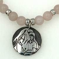 Rose quartz necklace with Quiet Time pendant, closeup of pendant.