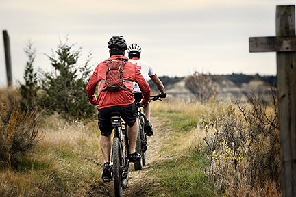 Two mountain bikers head south on the far north end of the trail
