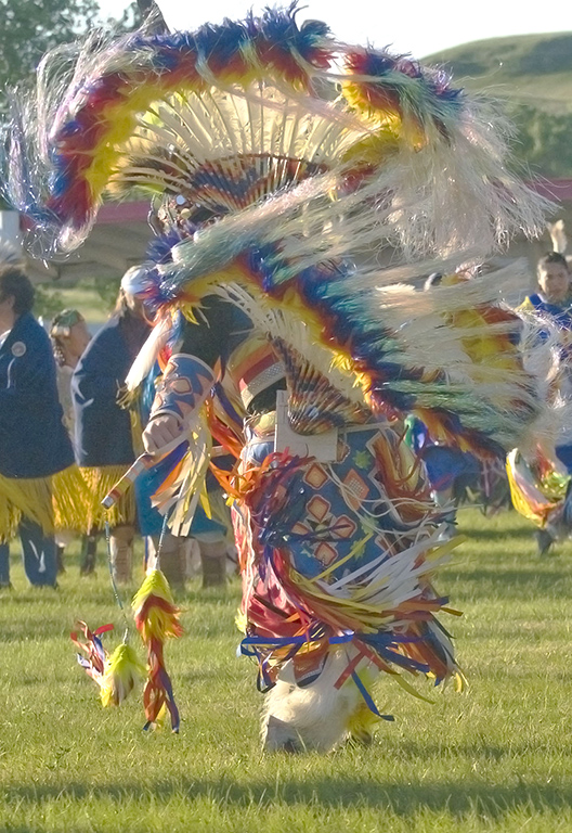Man's fancy dance contest accentuates the colors of the costume