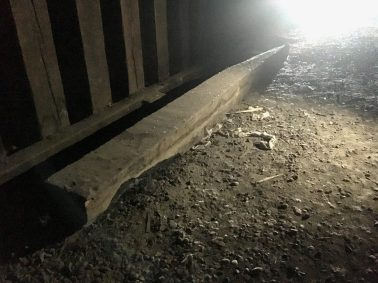 A beam lays in the tunnel, dragged there by vandals of the Cartwright Tunnel.