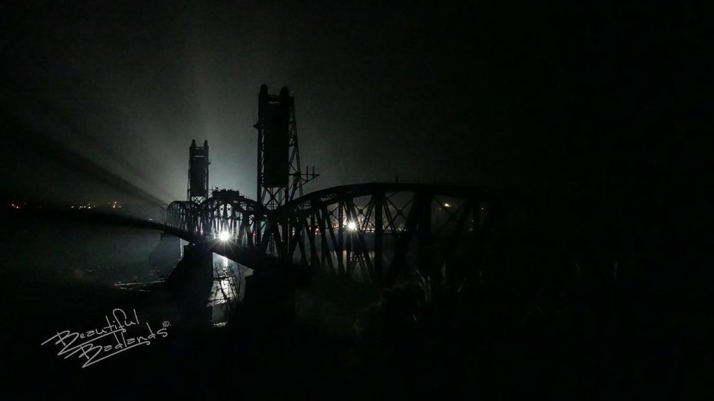 spotlights illuminted the superstructure of the through truss bridge and the counterweight towers that were designed to lift one section of the bridge
