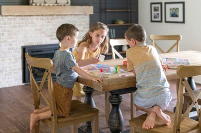 Kids playing at dining room table in new modern renovation
