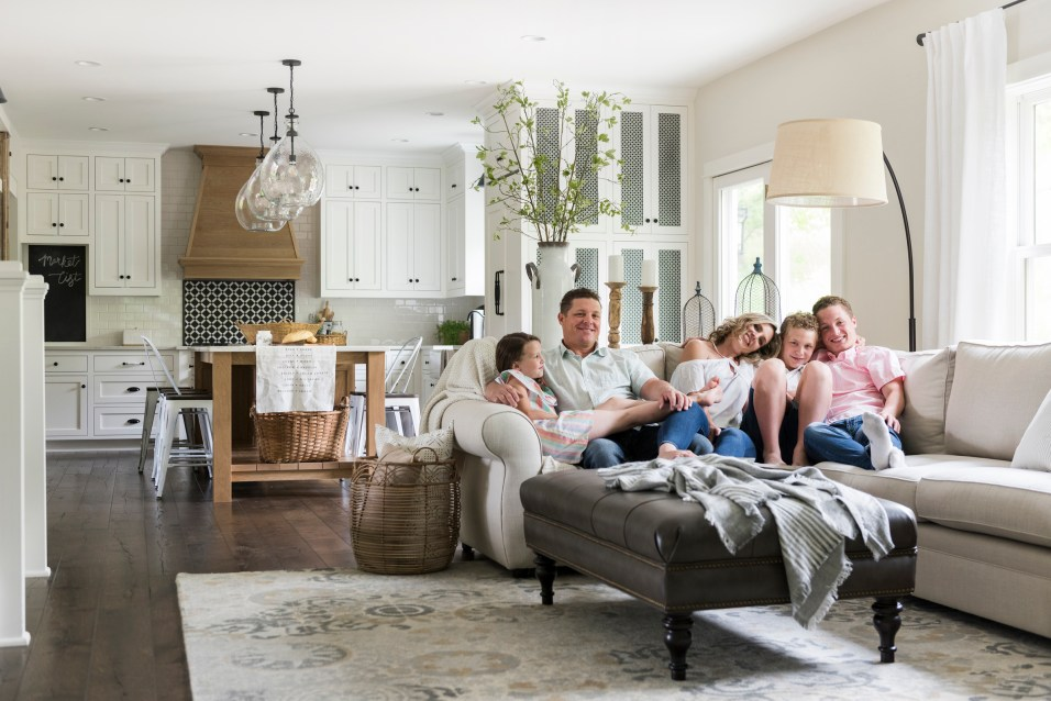 Family in Modern French Country Living Room