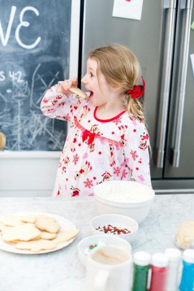 Daughter eating sugar cookies