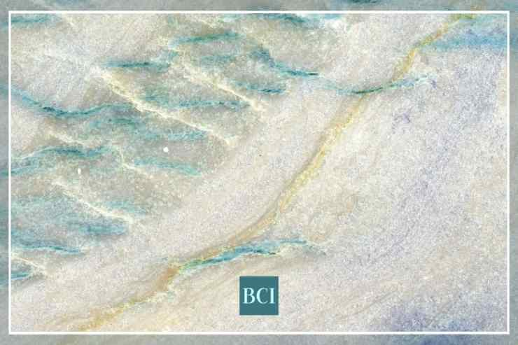 Photo of blue, green, and cream quartzite slab. Quartzite is quickly becoming one of the most popular types of stone countertops.