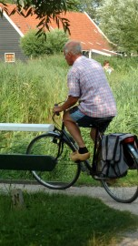 New Feat: Cycling with Clogs on the Feet Zaanse Schans, The Netherlands July 31, 2014
