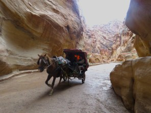 Horse Carriages take visitors through Petra's Siq - by Anika Mikkelson - Miss Maps - www.MissMaps.com
