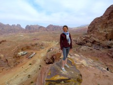Standing atop a rock looking over Petra's Valley and Wadi Musa - by Anika Mikkelson - Miss Maps - www.MissMaps.com