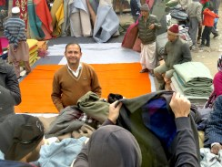 Sunday Market Salesman- Love how the blanket creates his own backdrop - New Delhi, India - by Anika Mikkelson - Miss Maps
