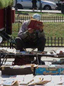 Pre-reading the goods at Lviv's Book Market - Lviv, Ukraine - by Anika Mikkelson - Miss Maps
