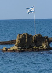 Israeli Flag waving in the Mediterranean Sea off Old Jaffa Coast - Tel Aviv Israel - by Anika Mikkelson - Miss Maps - www.MissMaps.com