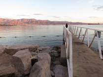 Watching the sunset from a fisherman's bridge in Eilat Israel - by Anika Mikkelson - Miss Maps - www.MissMaps.com