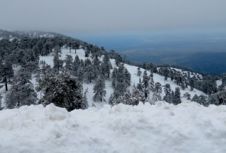 And then it snowed - Mount Olympos in Cyprus with views of the Mediterranean in the background - by Anika Mikkelson - Miss Maps - www.MissMaps.com