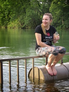 Happy not to have her feet in the water while sampling Semič Sparkling Wine at Big Berry Slovenia - by Anika Mikkelson - Miss Maps - www.MissMaps.com