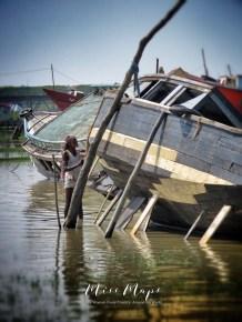 Man Working on a River Boat - Mongla Bangladesh - by Anika Mikkelson - Miss Maps - www.MissMaps.com