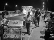Vendors on the Main Bridge at Night - Sylhet Bangladesh - by Anika Mikkelson - Miss Maps - www.MissMaps.com