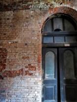 Battered Door at the Secretariat Building - Yangon Myanmar - by Anika Mikkelson - Miss Maps - www.MissMaps.com