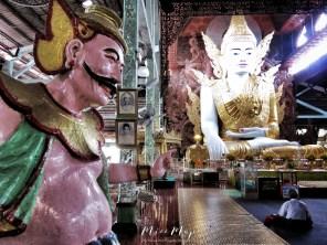Seated Buddha and Seated Buddhist at The Ngat Htat Gyi Pagoda - Yangon Myanmar - by Anika Mikkelson - Miss Maps - www.MissMaps.com