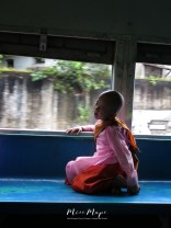 Young Nun on the Train - Yangon to Bago Myanmar - by Anika Mikkelson - Miss Maps - www.MissMaps.com
