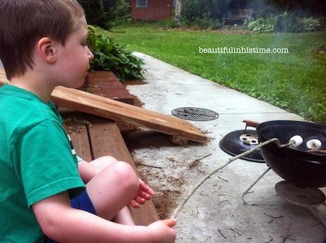 14 little boy roasting marshmallows