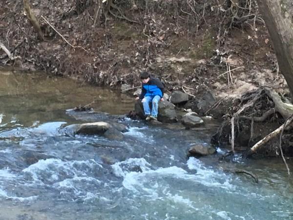 special needs child walk cross creek rocks