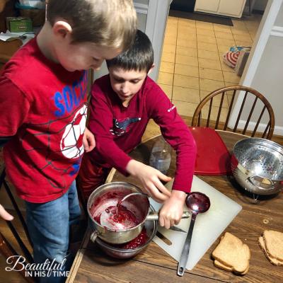boys making cranberry sauce Thanksgiving dinner