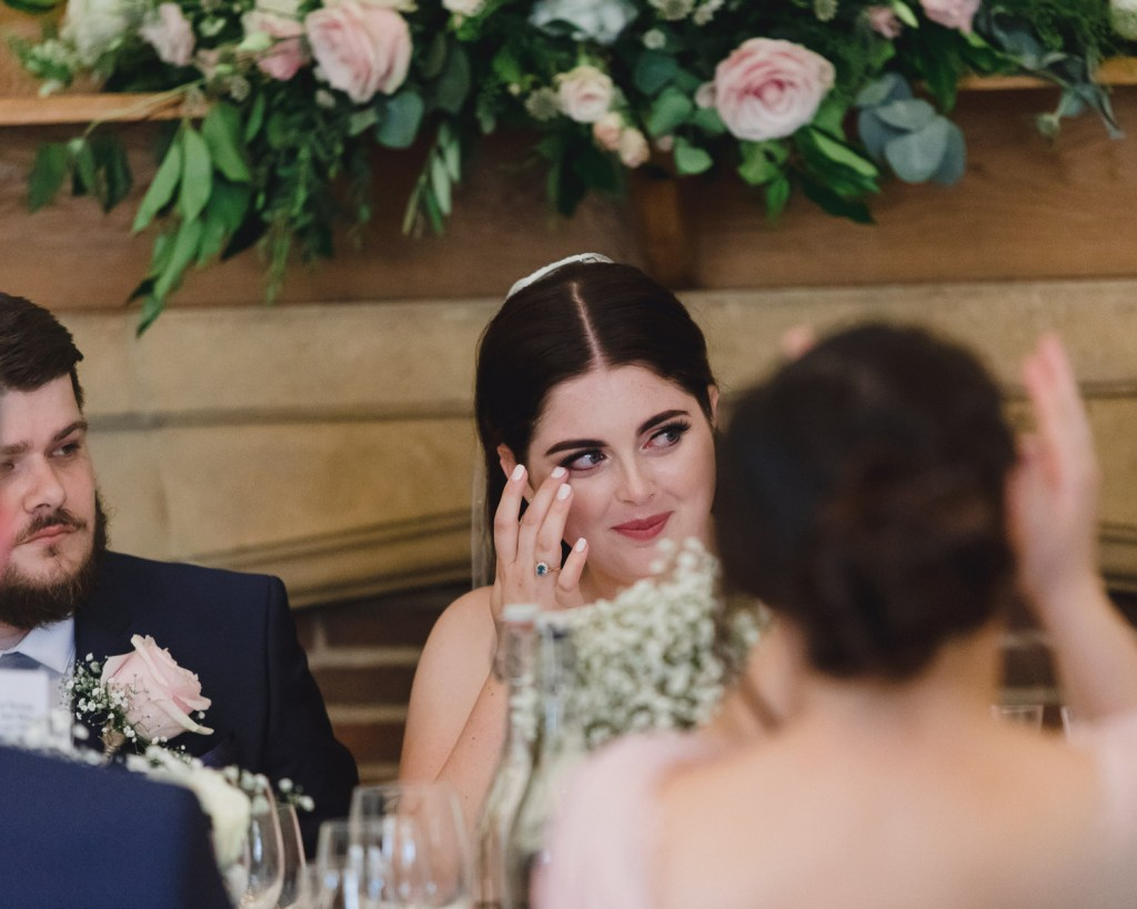 Bride wipes away a sentimental tear during speeches