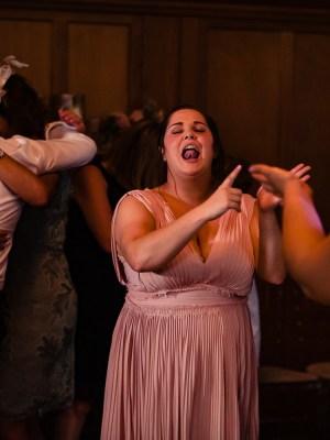Bridemaids singing on the dancefloor