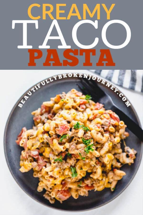 Cheesy, creamy, easy and on the table in under 30 minutes. This Creamy Taco Pasta is perfect for a weeknight dinner and makes great leftovers! #tacopasta #skilletmeal