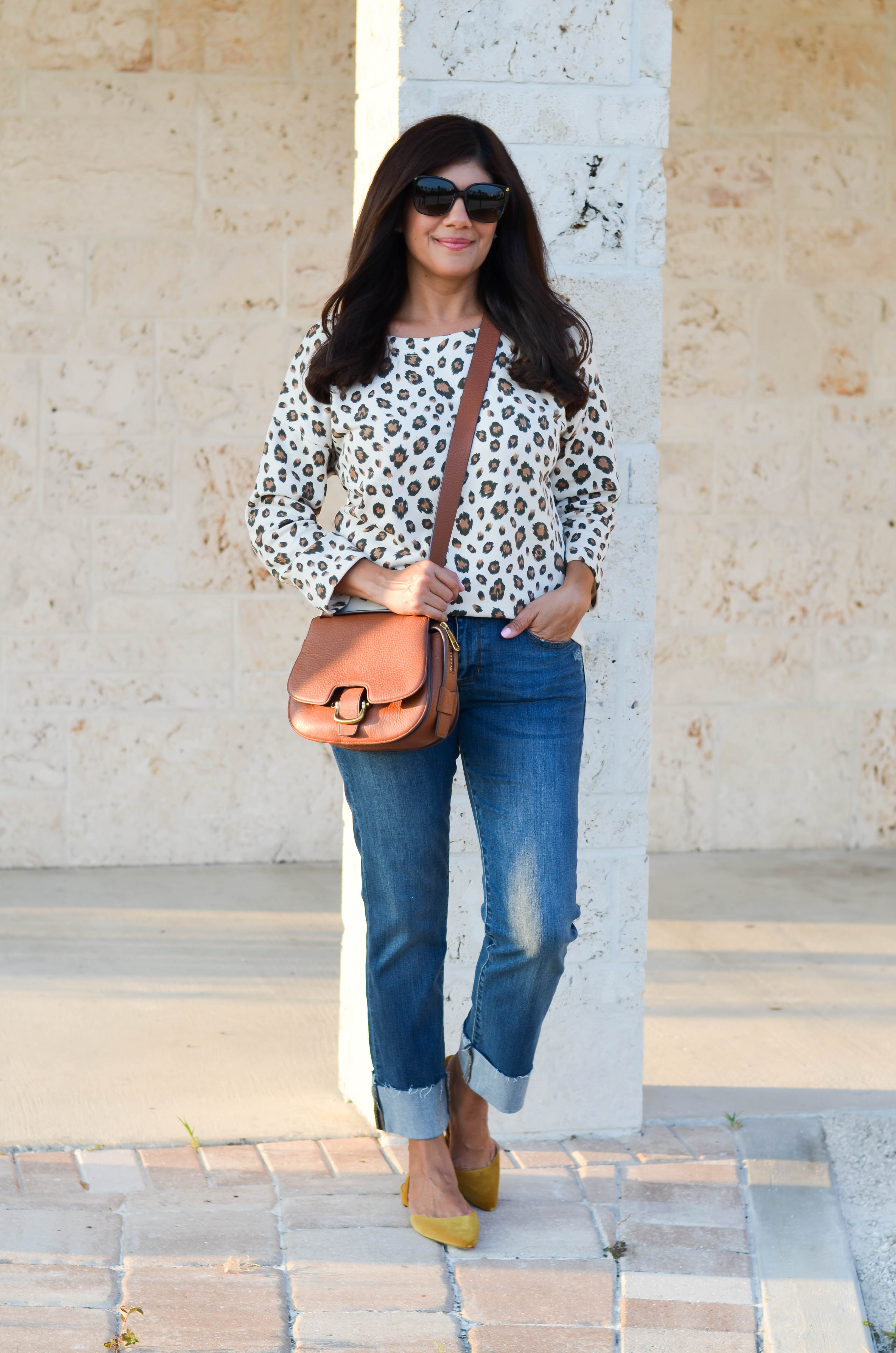 Lifestyle blogger, Desiree of Beautifully Seaside, styles a comfy fall leopard sweatshirt from J.Crew.
