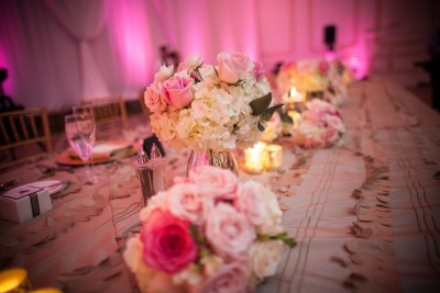 Low Pink and White Wedding Centerpieces with Pink Uplighting