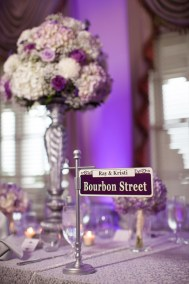 New Orleans Themed Purple and White Wedding Reception with Tall Centerpieces
