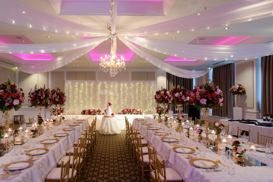 Peta-&-Dave-marriott-wedding-reception-styling-gold-candelabra-fresh-flower-florals-guest-table-centrepiece-white-ceiling-draping-fairylights-chandelier-bridal-backdrop