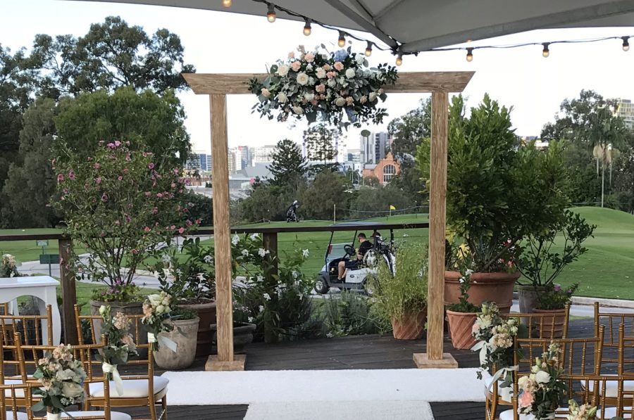 victoria-park-garden-marquee-deck-wedding-ceremony-timber-arch-fresh-florals