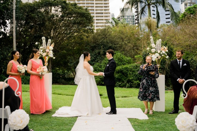 Samantha-&-Jordan-city-botanic-gardens-wedding-ceremony-styling-white-plinths-gold-urn-fresh-flower-florals-carpet-shepherds-hooks-rose-balls