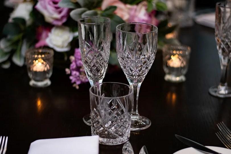 blackbird-wedding-reception-styling-clear-crystal-cut-stemware-glassware-tealights-faux-silk-flower-floral-centrepiece