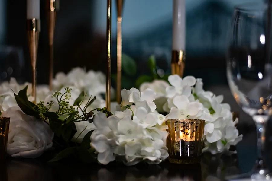 blackbird-wedding-reception-styling-gold-candelabra-candlestick-holder-guest-table-centrepiece-faux-silk-flower-florals-gold-tealights