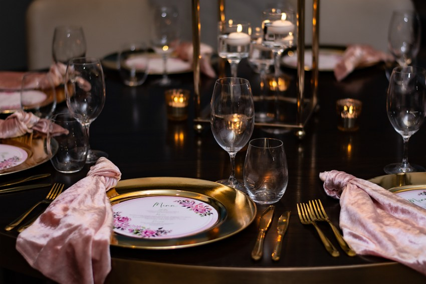 blackbird-wedding-reception-styling-gold-stand-table-centrepiece-floating-candles-gold-charger-plates-blush-velvet-napkins