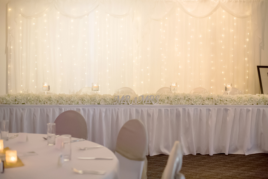 walkabout-creek-wedding-reception-styling-banksia-bridal-table-floral-runner-floating-candles-fairylight-backdrop