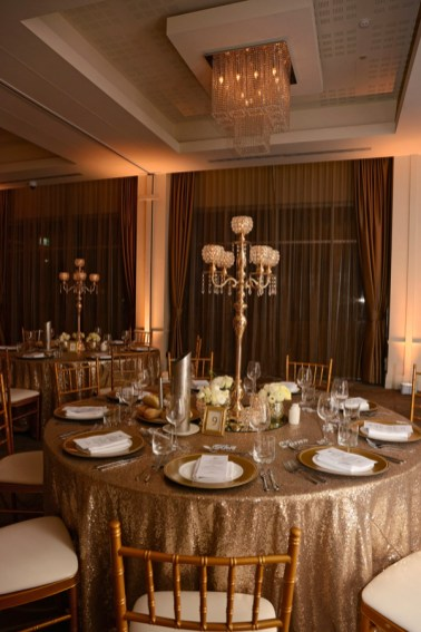 samantha-&-callum-easts-leagues-club-wedding-reception-styling-gold-diamante-candelabra-guest-table-centrepiece-tiffany-chairs-sequin-table-linen